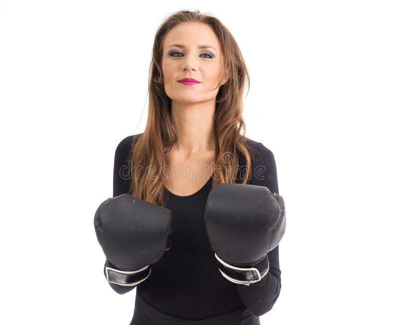 Woman wears boxing gloves. Person with green eyes and blonde hair.. stock images