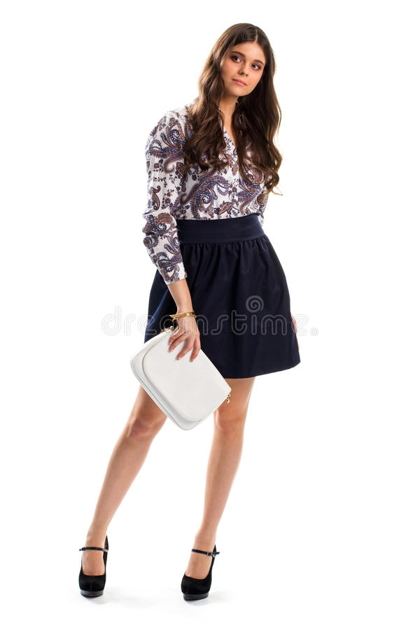 Woman wears floral shirt. Skirt and long sleeve shirt. Suede footwear of high quality. New collection of evening apparel royalty free stock photo