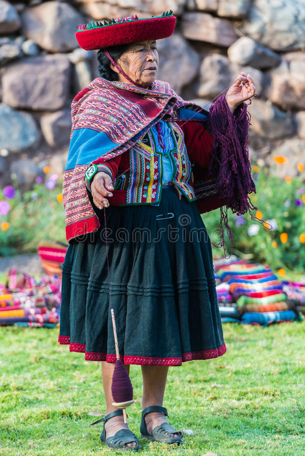 Woman weaving peruvian Andes Cuzco Peru royalty free stock photo