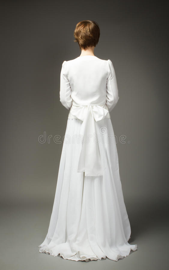 Woman in wedding dress back side royalty free stock images