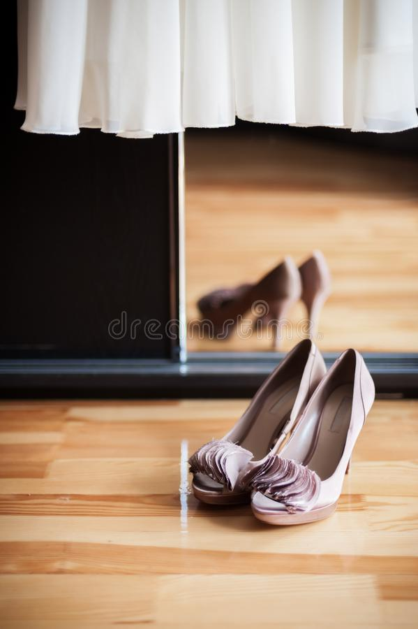 Woman Wedding Shoes and Wedding Dress in Mirror.  stock images