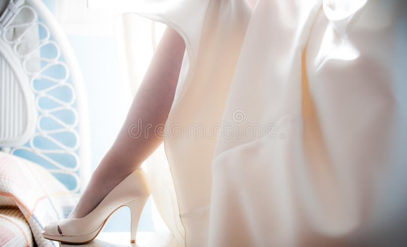 Woman before the wedding showng her socks stock images