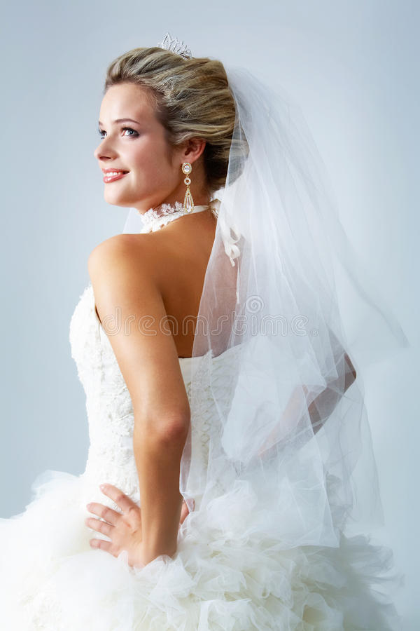 Woman in wedlock. Portrait of pretty bride posing in isolation royalty free stock image