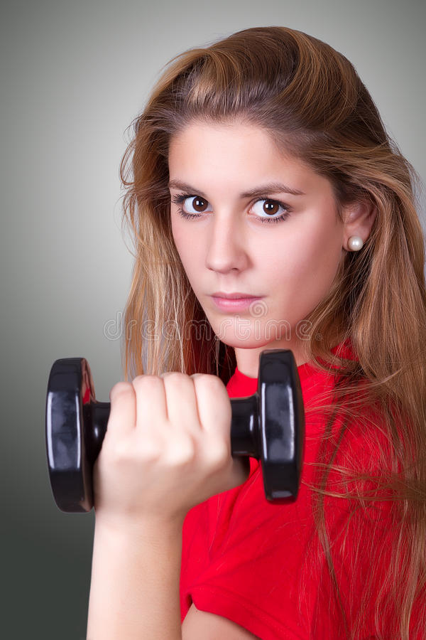 Woman With A Weight Royalty Free Stock Image