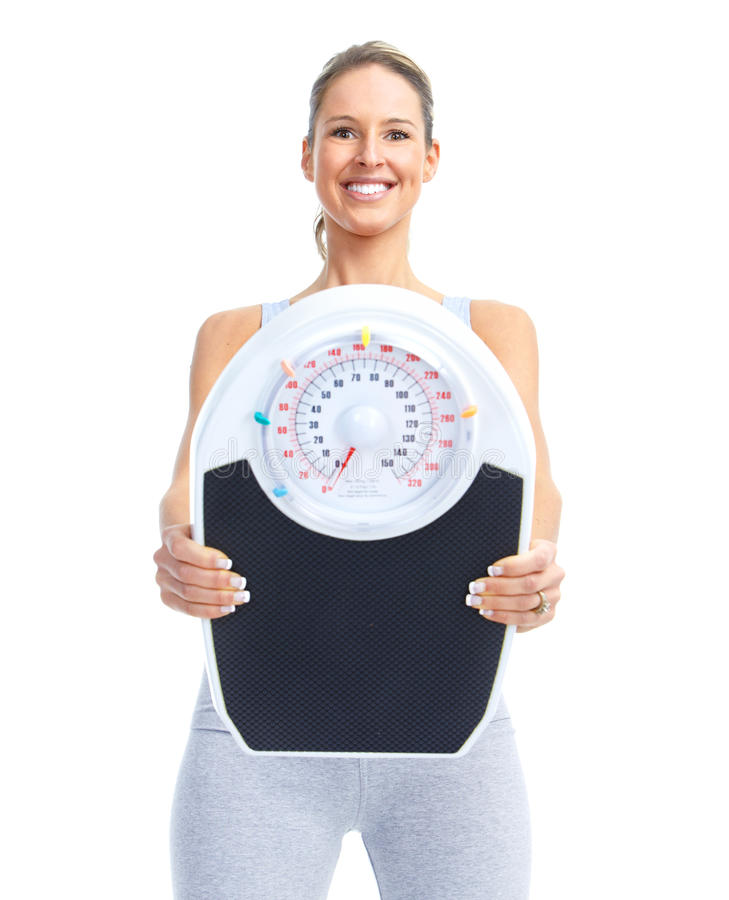 Woman with a weight scale. Healthy young woman with a weight scale. Isolated over white background royalty free stock image