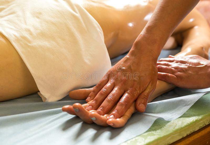 Woman in wellness beauty spa having aroma therapy massage with e royalty free stock photos