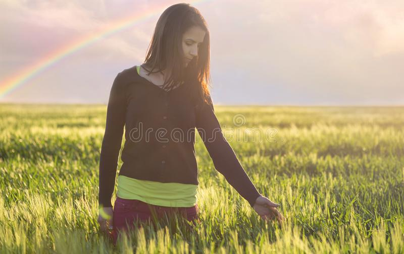 Woman in wheat field enjoying a good time. stock photography