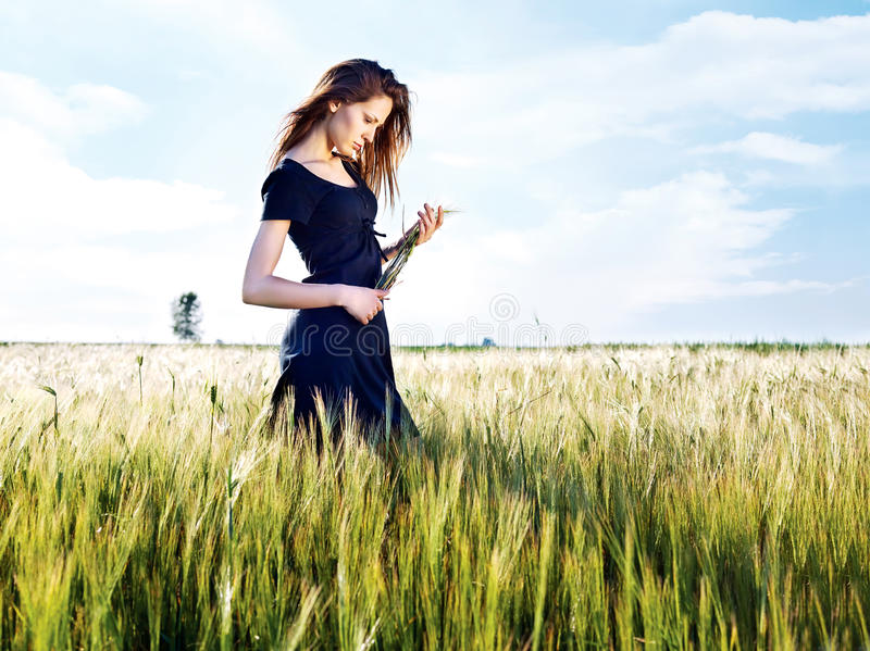 Woman At Wheat Field On Sunny Day Stock Photography