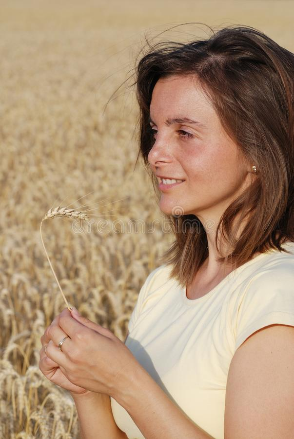 Download Woman with wheat in hands stock image. Image of hands - 23965553