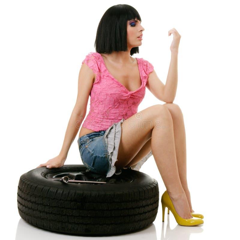Woman and wheel stock photos