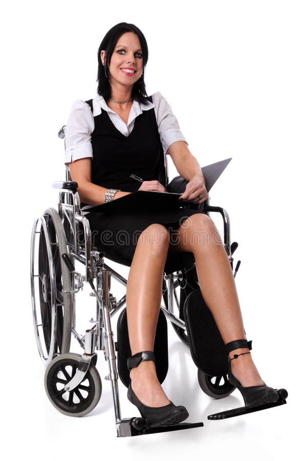 Woman on a Wheel Chair. Young woman on a wheel chair with folder and pen smiling stock photos