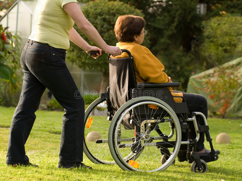 Woman in a wheelchair royalty free stock photo