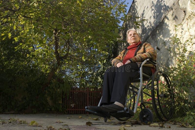 Woman in Wheelchair in Garden - Horizontal stock photography