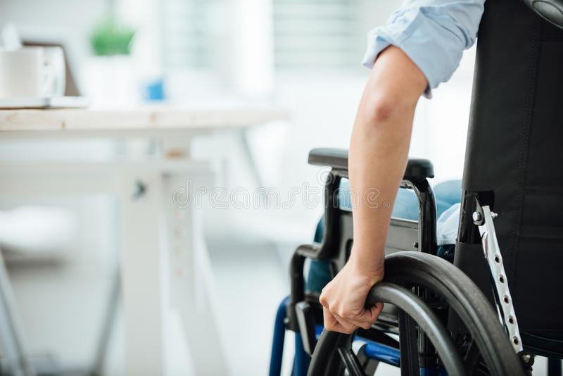 Woman in wheelchair royalty free stock photos
