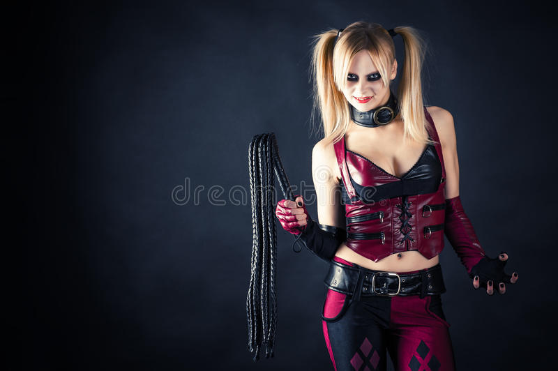 Woman with a whip stock image