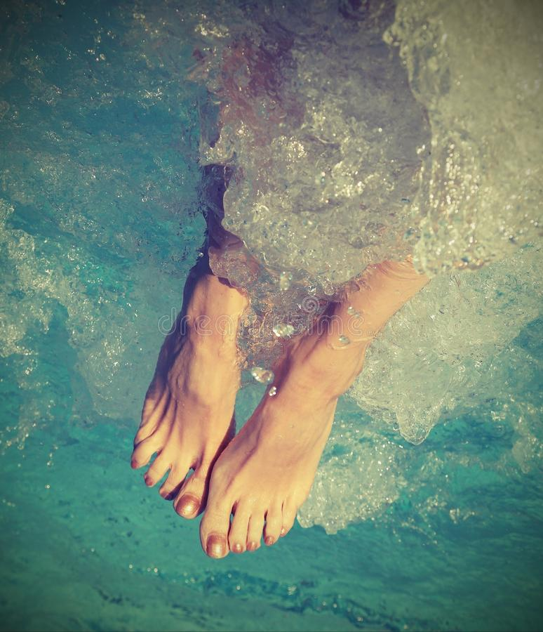 Feet Of Girl During The Whirlpool Therapy In The Spa Pool With V ...