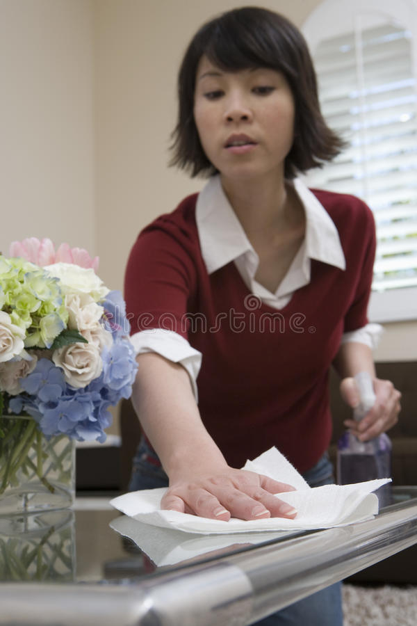Woman Whisking With Napkin Royalty Free Stock Image