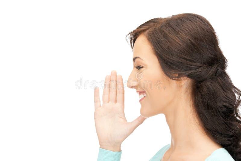 Woman whispering gossip stock image