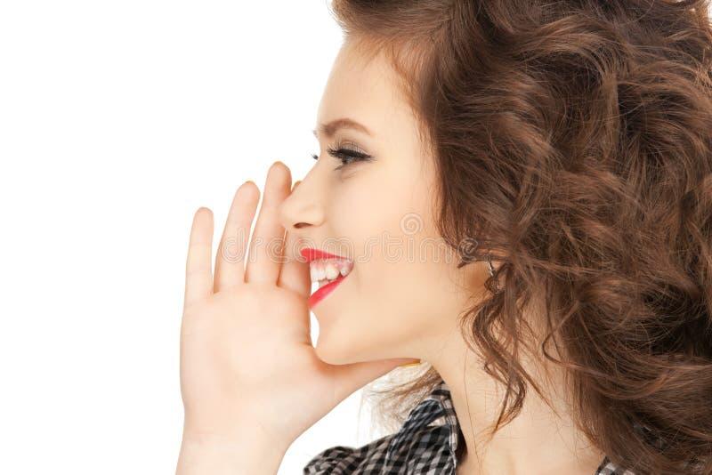 Woman whispering gossip stock photos
