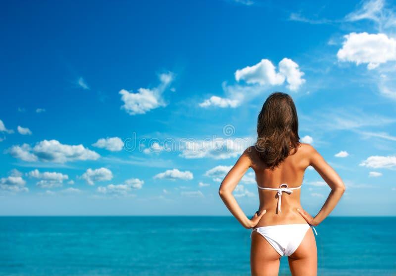 Download Woman In White Bikini At The Sea. Rear View. Stock Image - Image: 26623881