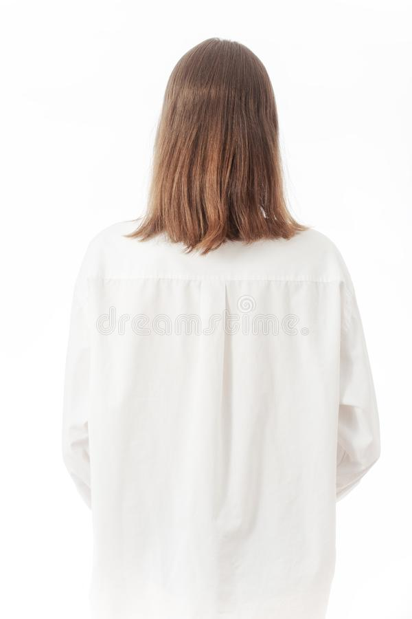 Woman in white blouse. Young woman in white blouse rear view on white background stock photos