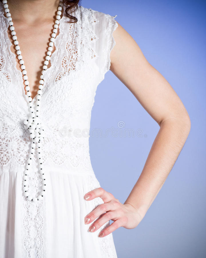 Woman in white bridal dress with beads stock photo
