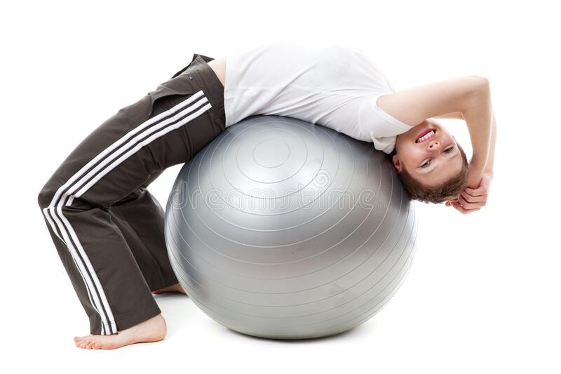 Woman in White Cap Shirt on Stability Ball royalty free stock images