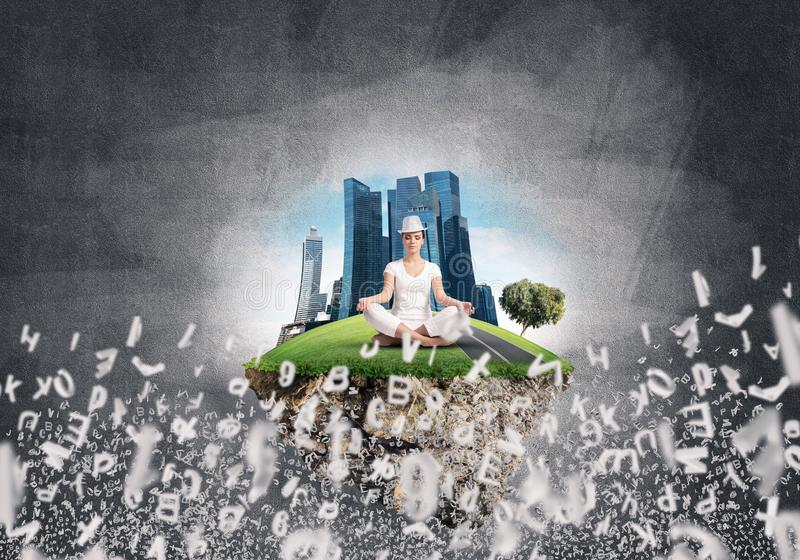 Young woman keeping mind conscious. Woman in white clothing keeping eyes closed and looking concentrated while meditating on island in the air among flying royalty free illustration