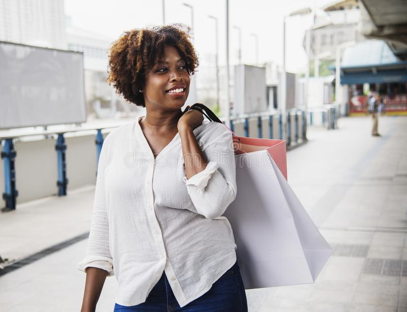 Woman in White Collared Button-up Long-sleeved Top Carrying White Bag royalty free stock photography