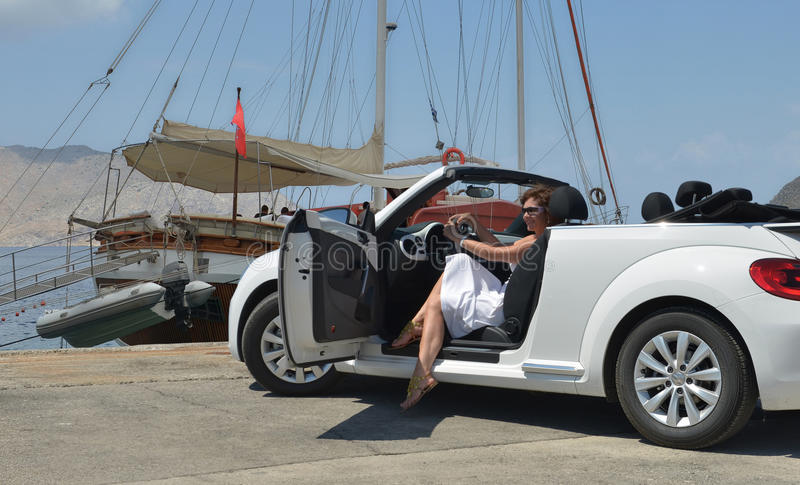 A woman in a white convertible royalty free stock images