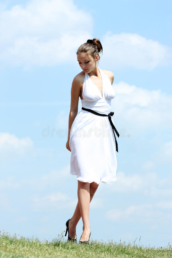 Woman in white dress royalty free stock photo