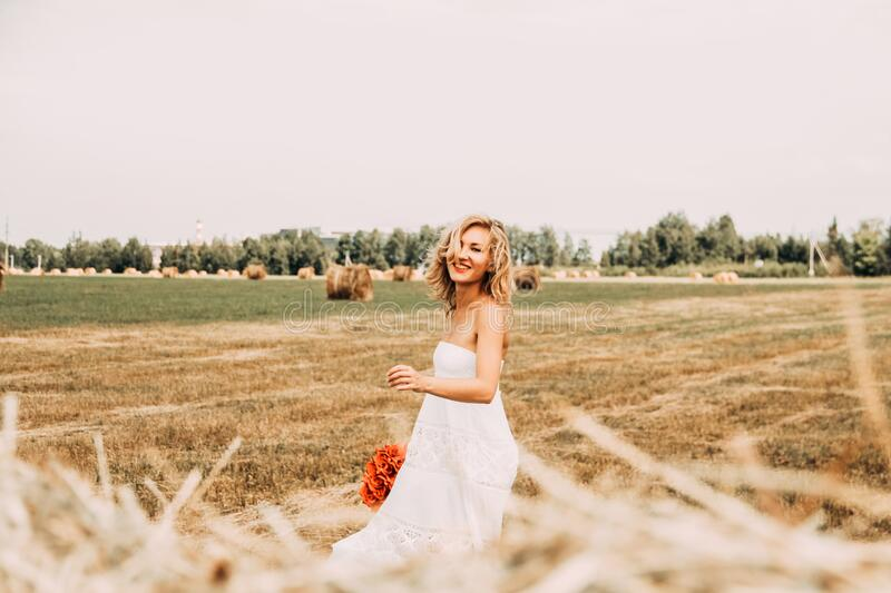 Woman in white dress on field royalty free stock photo