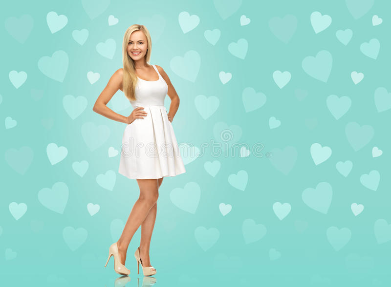 Download Woman In White Dress Over Blue Background Stock Photo - Image: 37706542