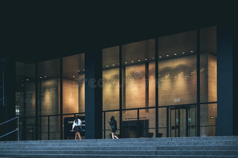 Woman In White Dress Shirt And Black Skirt Walking In Front Of Building Free Public Domain Cc0 Image