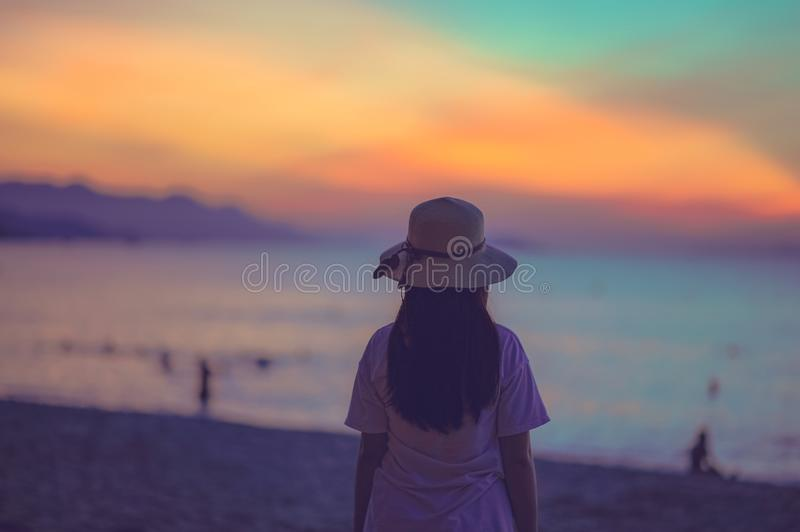 Woman in White Dress Standing Near Beach during Sunset royalty free stock photos