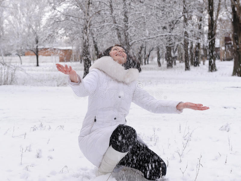 Download Woman In White And Falling Snow Stock Photo - Image: 23056714