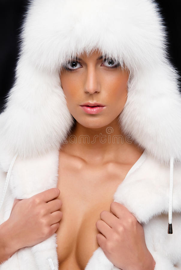 Download Woman In White Fur Coat And Hat Stock Photo - Image: 22843482