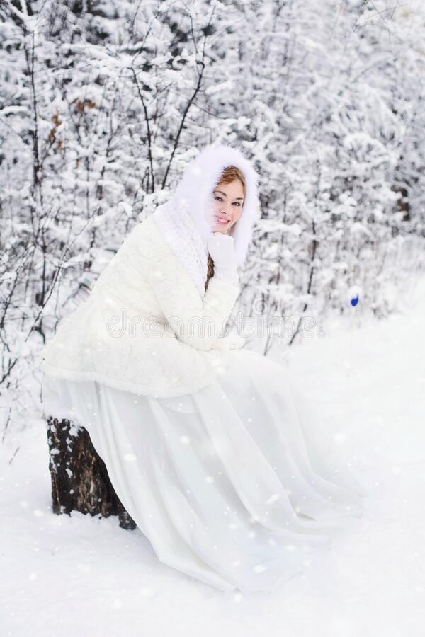 Woman In White Fur Hooded Dress In White Snow Filed Free Public Domain Cc0 Image