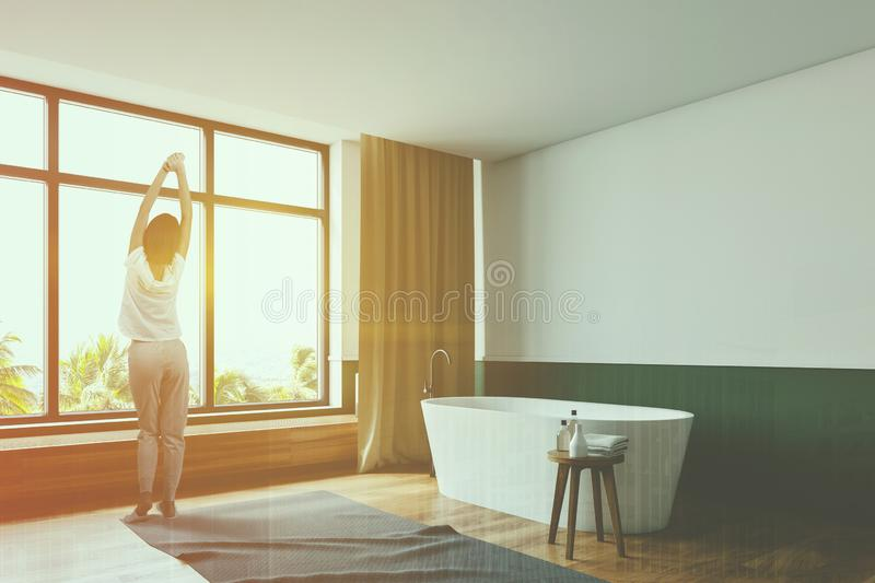 Woman in white and green bathroom corner stock photos