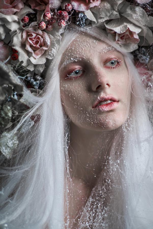 Woman with white hair and white roses royalty free stock photos