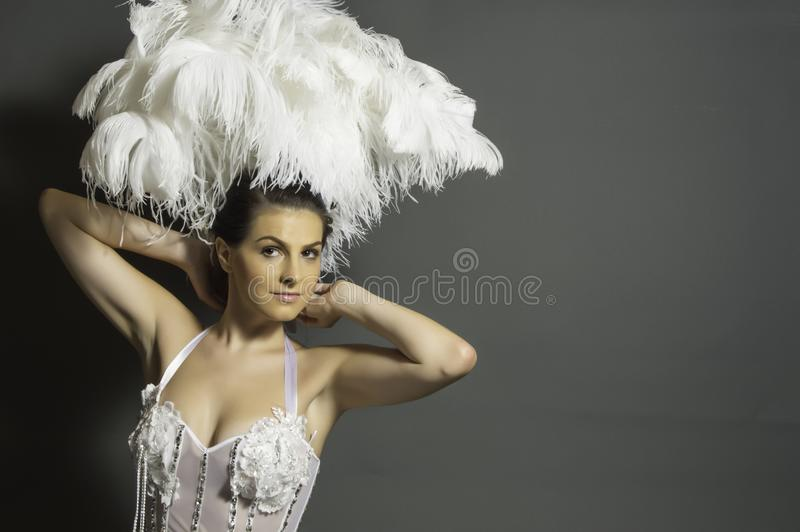 Woman in White Headdress and White Mesh Top royalty free stock photos