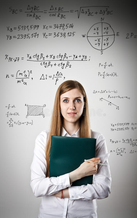 Woman in white is holding a folder. Equation. Woman in white is holding pen and documents and solving equation stock photo