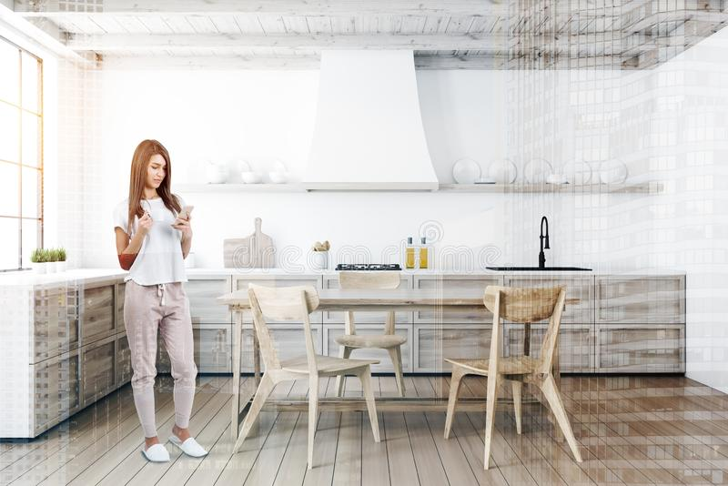 Woman in white kitchen with table royalty free stock photography