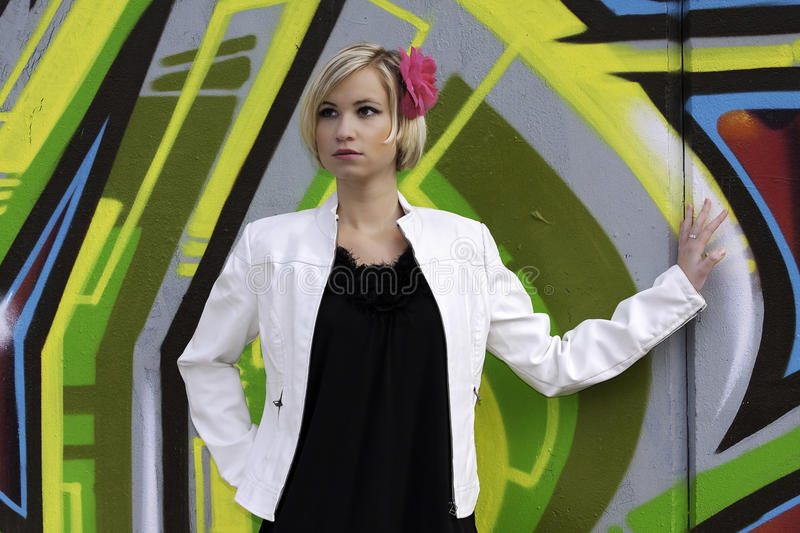 Download Woman in white leather stock image. Image of graffiti - 25620355