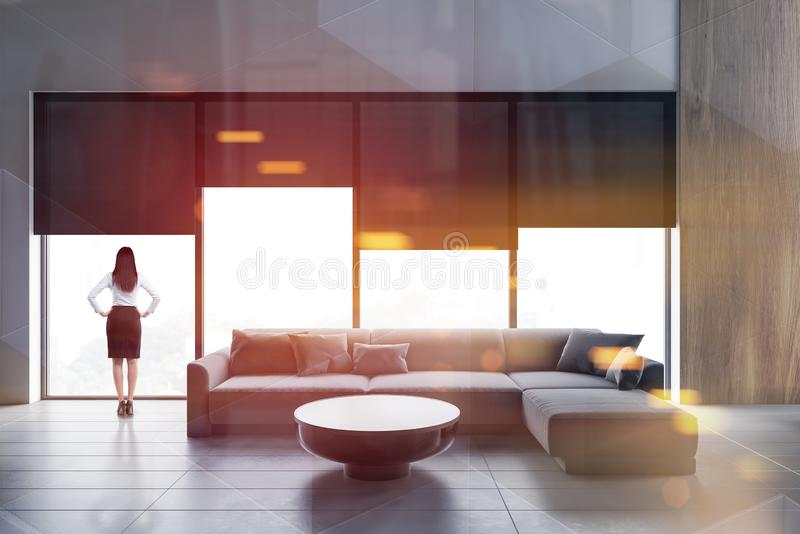 Woman in white living room with sofa royalty free stock photo