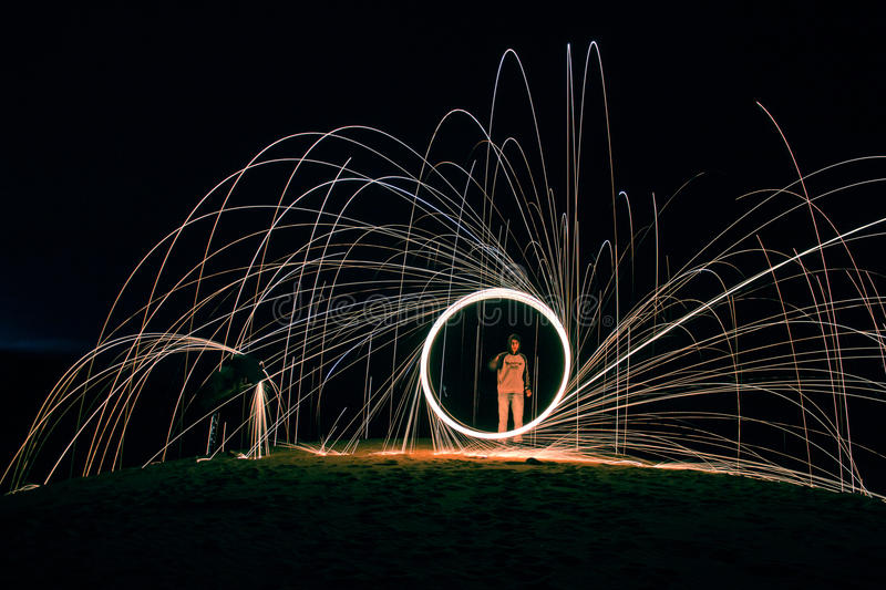 Woman In White Long Sleeve Shirt Standing In The Center Of Round Firework Light Free Public Domain Cc0 Image