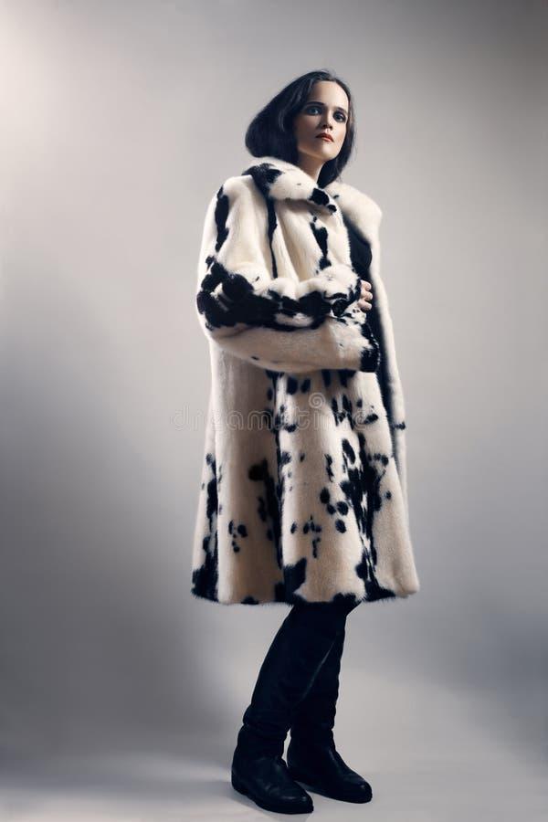 Woman in white mink spotty fur coat