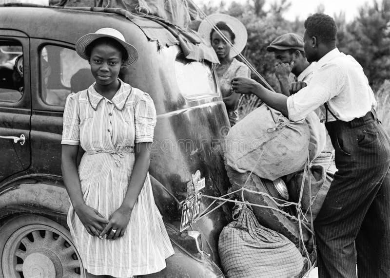 Woman in White Pinstripe Dress Near Black Vintage Car stock images