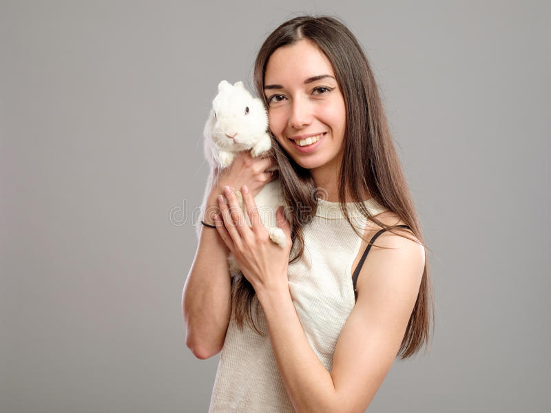Woman with white rabbit royalty free stock photography