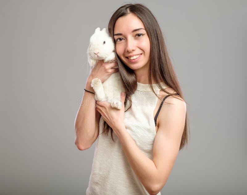 Woman with white rabbit royalty free stock photos